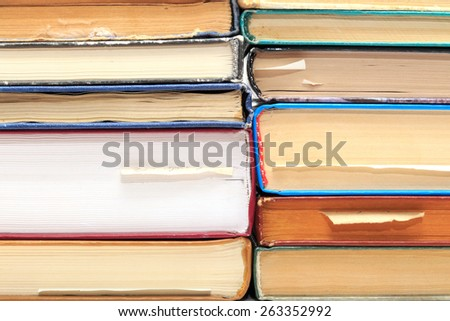 A stack of old books with bookmarks - stock photo