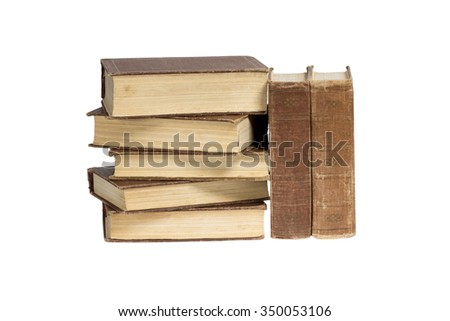 A stack of old-fashioned books on a white background. Clipping path.