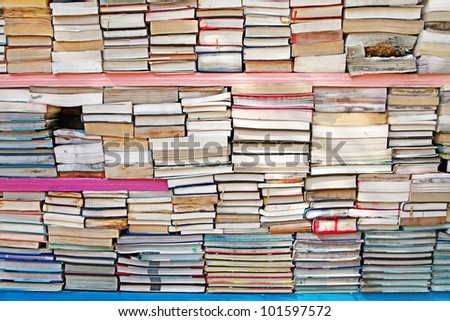 A stack of old wet and damaged used books. - stock photo