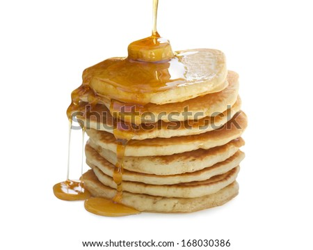 A stack  of pancakes with maple syrup and melted butter. Isolated on white.