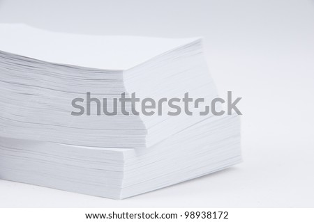 A stack of paper on a white background. - stock photo