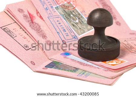 a stack of passports and stamp isolated on white - stock photo