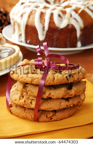 A stack of peanut butter cookies gift wrapped with a bow
