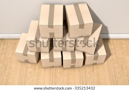 A stack of regular brown cardboard boxes taped shut on an an an empty house floor and wall background - stock photo
