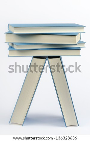 A stack of some closed blue books - stock photo