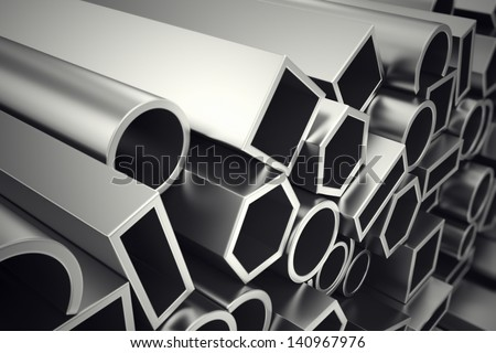 A stack of steel profiles in different shapes. They are designed to meet high demands for performance, quality and precision. They are used in construction and manufacturing. - stock photo