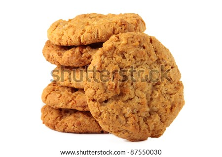 "A stack of sweet biscuits, known in Australia as ""ANZAC"" biscuits. Isolated on a white background."