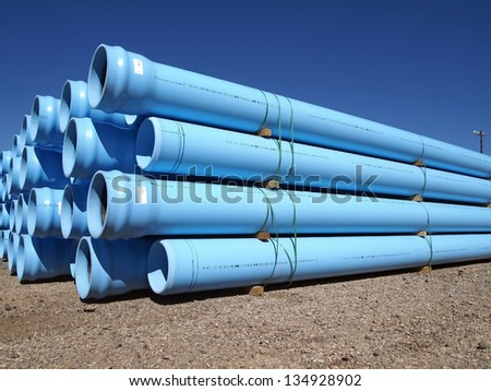 A stack of water pipe at a construction site.