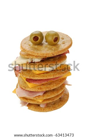 A stack of wheat crackers on white