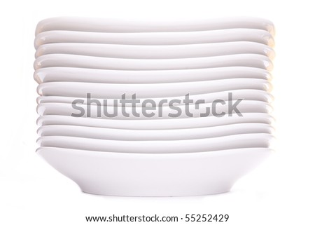 a stack of white dishes isolated on white - stock photo