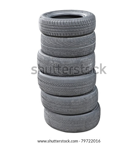 A stack of worn out  rubber tire isolated against white. - stock photo