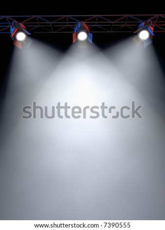 A Stage Light Rack with 3 Spotlights Shining down towards the middle of the layout in a dark area. - stock photo