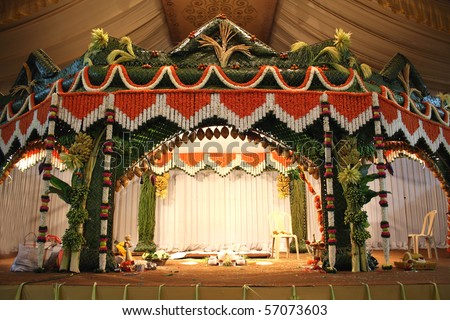 A stage traditional decorated for a hindu wedding. - stock photo