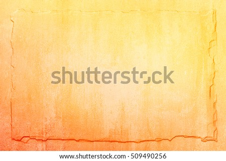 A stained concrete wall made to look like a slate tablet with a raised, three-dimensional look.  Image displays a reddish orange to yellow gradient.