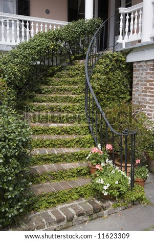 A stairway entrance to a historic mansion in downtown Charleston, South Carolina. - stock photo
