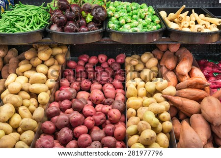 A stand with variety potatoes tubers and fresh produces in a supermarket at Colfax, Whitman County, Washington, USA. Concept of pattern texture and background. - stock photo