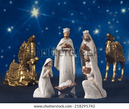 A star-lit nativity scene composed of the three wisemen, their camels, Mary and baby Jesus.   - stock photo
