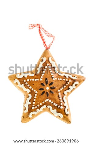 a star shaped gingerbread christmas ornament isolated over a white background - stock photo
