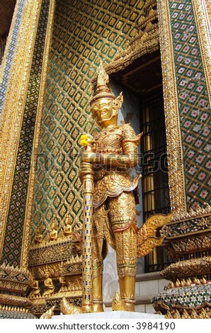 A statue of a demon guardian at the Buddhist temple of Wat Phra Kaeo at the Grand Palace in Bangkok, Thailand.