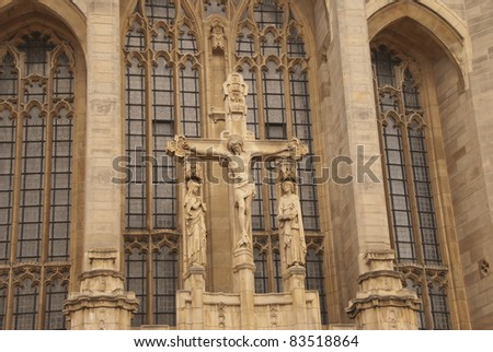A Statue of Christ on the Cross on a Cathedral in England - stock photo