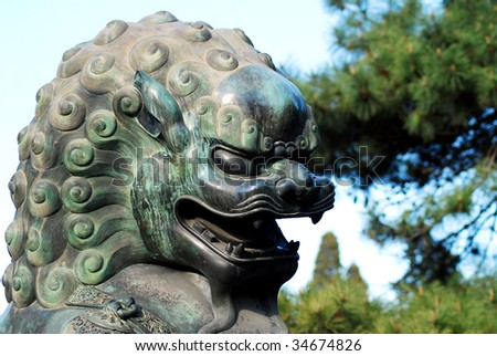 A statue of copper lion at the gate of Summer Palace in Beijing, China