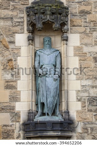 A statue of Sir William Wallace on the facade of Edinburgh Castle in Scotland. - stock photo