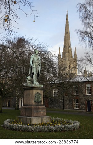 A statue of Wellington with the spire of Norwich Cathedral in the background