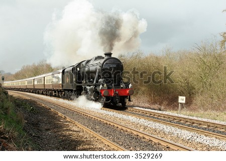 A steam engine on the main line. - stock photo