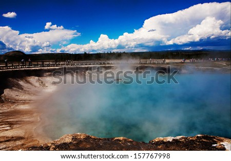 A steaming pool of water bubbles in Yellowstone National Park, Wyoming