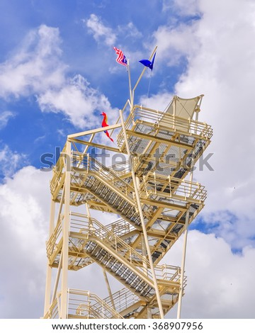 A steel Lookout Tower (or observation/watch tower) with Malaysian Flag in a sunny day at Putrajaya, the federal administrative capital of Malaysia. - stock photo