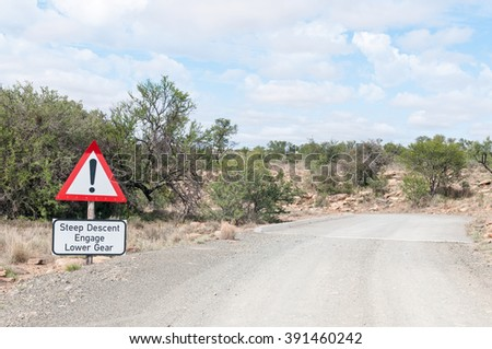 A steep descend warning on the link road in the Mountain Zebra National Park near Cradock in South Africa - stock photo