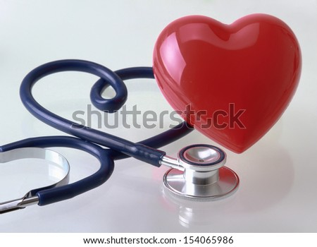 A stethoscope in the shape of a heart - stock photo