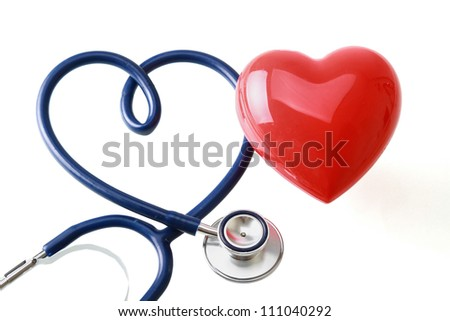 A stethoscope in the shape of a heart and red heart, isolated on white background - stock photo