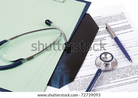 a stethoscope on a medical billing statement - stock photo