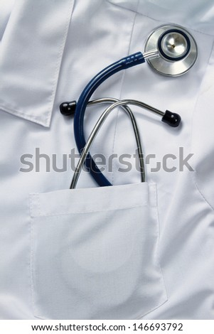A stethoscope  on a medical uniform, closeup