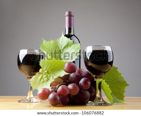 A still life composition with grape and wine. - stock photo