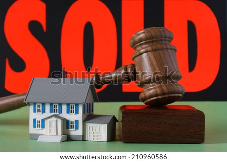 A still life image to bring focus to the sales of real estate properties in the marketplace. - stock photo