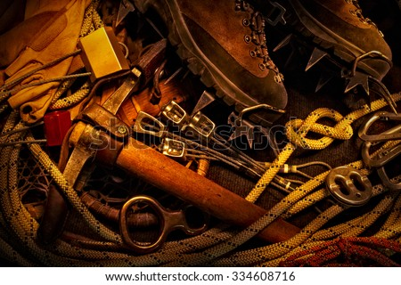 A still life light painting of modern and antique rock climbing gear - stock photo