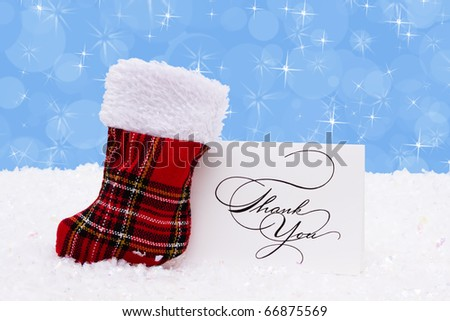A stocking with a thank you card on a snow background, Christmas Time - stock photo
