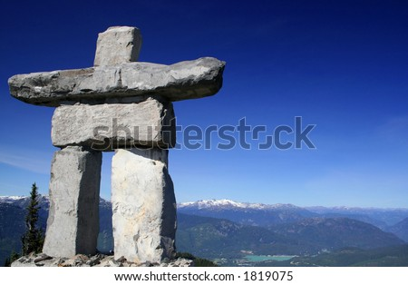 A stone figure extends a warm welcome to people from around the world visiting Whistler, BC, Canada. - stock photo