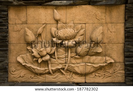 A stone inscription of a flower, Thai style of buddhism - stock photo