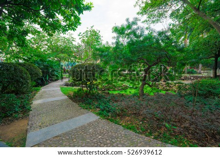 A stone walkway in South Gate Park of Huizhou West Lake Scenic Area