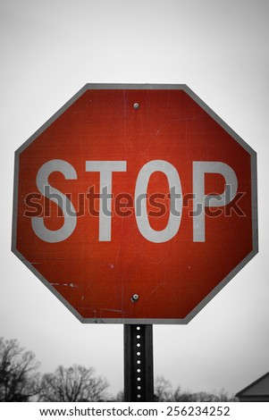 A stop road sign or symbol in vintage style - stock photo