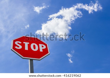 A stop sign against a blue sky.