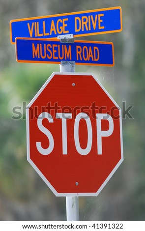 A stop sign at the corner of Village Drive and Museum Road near Lake Alice, a popular spot on the University of Florida Campus in Gainesville, Florida. - stock photo