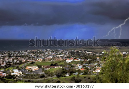 A storm passes through San Clemente with rain in the background - stock photo