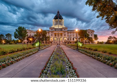 A storm rolls in at dawn at the South Dakota State Capitol building in Pierre, South Dakota - stock photo