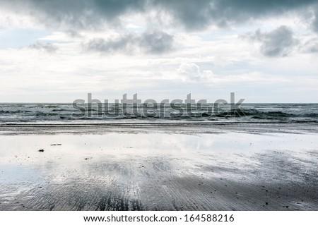 A stormy day on a beach near Borth. - stock photo