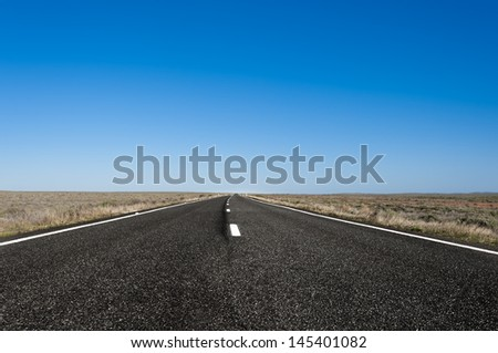 a straight road in outback Australia, somewhere between Broken Hill and Dubbo - stock photo