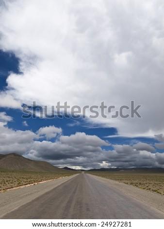 A straight road to the infinite horizon. No lane line. - stock photo